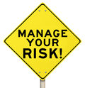 Manage your risk management yellow warning sign words on a road to illustrate the need to reduce danger and opportunity for loss Stock Photos