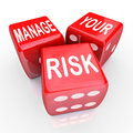 Manage your risk words dice reduce costs liabilities in a dangerous world company workplace or enterprise by reducing and Royalty Free Stock Photography