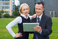 Manager and assistant with tablet Royalty Free Stock Image