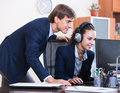 Manager consulting call center operator in office successfull european Royalty Free Stock Photo