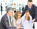 Manager discussing work with his colleagues business meeting Stock Image