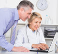 Manager and doctor reading news Royalty Free Stock Photo