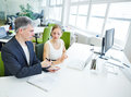 Manager giving order to assistant in office his business Stock Images