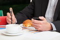 Manager in a stressful work with coffee and croissant Royalty Free Stock Photo