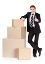 Manager in suit stands near pile of containers Royalty Free Stock Photos