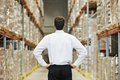 Manager in warehouse male man standing big modern with back towards viewer Stock Images