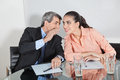 Manager whispering into ear Royalty Free Stock Photo