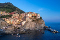 Manarola before sunset a picturesque coastal village with colorful old houses in cinque terre italy Stock Photo