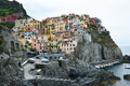 Manarola town with its colorful traditional houses on the rocks over Mediterranean sea, Cinque Terre National Park and UNESCO