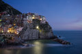 Manarola village on cliff rocks and sea at sunset seascape in five lands cinque terre national park liguria italy europe square Royalty Free Stock Images