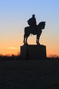 Manassas battlefield stonewall jackson monument silhouette of the on horse at civil war park in virginia at sunset Royalty Free Stock Image