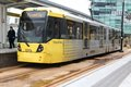 Manchester tram uk april people board on april in uk metrolink serves million rides anually Royalty Free Stock Photography
