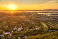 Mandalay seen from hill at sunset burma with lake mountains temples and pagodas Royalty Free Stock Photography