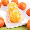 Mandarin fruit with honey sauce and almond Royalty Free Stock Photo