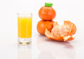 Mandarin juice fresh fruit and on white Royalty Free Stock Photos