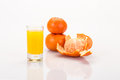 Mandarin juice fresh fruit and on white Stock Image
