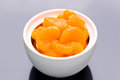 Mandarin orange on a black reflective background in a b Royalty Free Stock Photo
