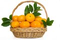 Mandarin orange fruit in a wicker basket fruits and leafs on white background Royalty Free Stock Images