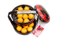 Mandarin oranges in basket with red envelope good luck character juicy traditional carrier chinese on packets white background Stock Image