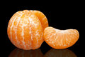 Mandarin without a peel is isolated on black background Royalty Free Stock Images
