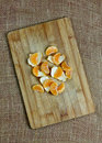 Mandarin segments on wooden board still life Stock Photos