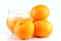 Mandarins and juice with in glass on background Royalty Free Stock Image
