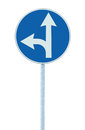 Mandatory straight or left turn ahead, traffic lane route direction sign pointer road sign, choice concept, blue isolated signage Royalty Free Stock Photo