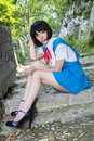 Manga schoolgirl beautiful model posing in black wig as a japanese Stock Photo