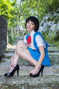 Manga schoolgirl beautiful model posing in black wig as a japanese Stock Photo
