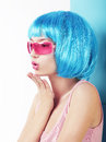 Manga style woman in blue wig blowing a kiss profile of charismatic Royalty Free Stock Photos