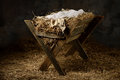 Manger in stable with hay and swaddling clothes old Royalty Free Stock Photo