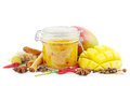 Mango chutney on white homemade in a glass jar with spices and mangoes Royalty Free Stock Image