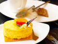 Mango cream tart on the coffee table Royalty Free Stock Image