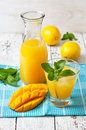 Mango ice tea with mint in a glass Royalty Free Stock Photo