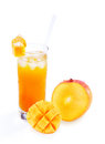 Mango and mango juice in a glass with straw one whole cut square cut slice accompanying of chilled drink on isolated white Stock Photos