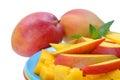 Mango slice and cube on dish isolated on white Royalty Free Stock Image