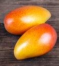 Mango On Wood Background. Orga...