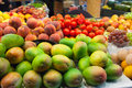 Mangoes in the market and other fruits spanish Stock Photos