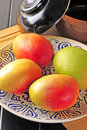 Mangos fresh on white plate Stock Photography