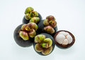 Mangosteen and cross section showing the thick purple skin and w white flesh of queen of friuts Stock Images
