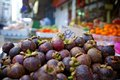 Mangosteen fruit in a market in bangkok thailand Stock Images