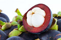 Mangosteens pile of on white back ground Royalty Free Stock Images