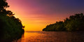 Mangrove blue river leading to the open sea Trinidad and Tobago colourful sunset Royalty Free Stock Photo