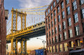 Manhattan Bridge Between Renovated Old Warehouses Royalty Free Stock Photo