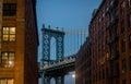 Manhattan Bridge seen from Dumbo between brick buildings on Brooklyn at sunset - New York, USA Royalty Free Stock Photo