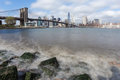 Manhattan and brooklyn bridge from the hudson river skyline with waves ot Stock Image