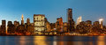 Manhattan late evening new york city skyline panorama with lights and reflections Royalty Free Stock Photos