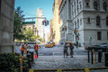 Manhattan municipal building new york city usa august two land surveyors are working in front of the while two ladies are having a Stock Images