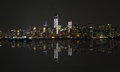 Manhattan at night, New York City skyline with reflection in Hudson River Royalty Free Stock Photo