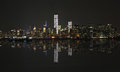 Manhattan at night, New York City skyline with reflection Royalty Free Stock Photo